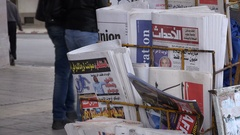Closeup of newspapers (in Arabic and French) on streets Rabat in Morocco Stock Footage