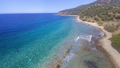 4K Ascending aerial footage view of a Greek beach Stock Footage