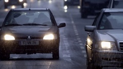 Road traffic in winter while snow fall Stock Footage
