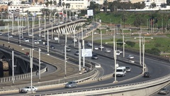 Traffic drives over modern bridge and highway in Rabat, Morocco's capital city Stock Footage