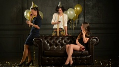 Everyone is Talking by Smartphone at the Party. Three Pretty Women are Having Stock Footage