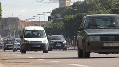 Traffic drives over wide boulevards in Rabat, Morocco's capital city Stock Footage