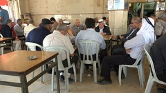 Palestinian men play cards in coffee house, traditional Arabic culture Stock Footage