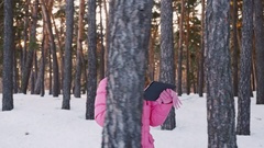Young woman walking on a snow-covered forest, checks its way across the tablet Stock Footage