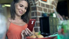 Young woman taking photo of food and drink with cellphone sitting in cafe  Stock Footage
