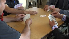 Closeup of Palestinian men playing cards in a tea house in Ramallah Stock Footage