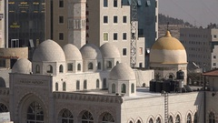Closeup of domes of a large mosque in downtown Ramallah city Stock Footage