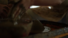 Woman's hands makes a pot on pottery wheel Stock Footage
