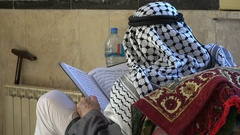 Palestinian man reading the Quran in a mosque in Ramallah Stock Footage