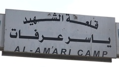 Entrance to the permanent Palestinian refugee camp (Al Amari) in Ramallah Stock Footage