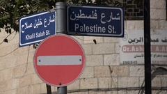 Symbolic traffic signs in Palestine street in Ramallah in the West Bank Stock Footage