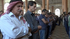 Palestinian Muslims pray inside the main mosque in Ramallah in the West Bank Stock Footage