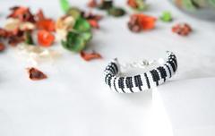 Beaded crochet bracelet like piano keyboard close up Stock Photos