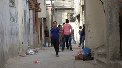 Palestinian kids play football (soccer) in permanent refugee camp Ramallah Stock Footage