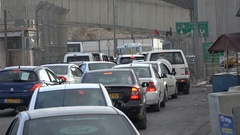 Traffic jam in front of the Qalandia checkpoint between Ramallah and Jerusalem Stock Footage