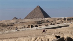 The Great Pyramid of Kheops in Giza with Camel Stock Footage