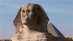 The Great Sphinx and kheops pyramid of Giza close up Stock Footage