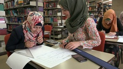 Muslim girls with colorful headscarves study in university Ramallah Stock Footage