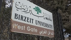 Entrance sign to the Bir Zeit University in Ramallah in the West Bank Stock Footage