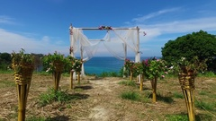 Aerial: Flying through the wedding arch to the sea. Stock Footage