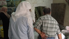 Families bring olives to a small olive oil factory in Ramallah in the West Bank Stock Footage