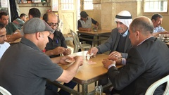 Senior Palestinians play cards in a traditional tea house in West Bank Stock Footage