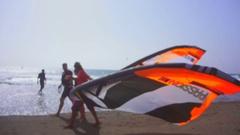 Kite surfers are on the seashore Stock Footage