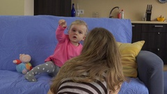 Mom try interrupt baby daughter girl watching television Stock Footage
