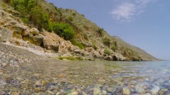 Crystal clear sea water wild beach Stock Footage