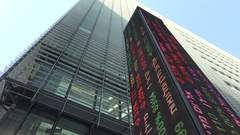 Pillar with share prices at facade Tel Aviv stock exchange Israel Stock Footage