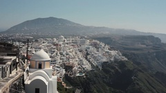Overlooking the town of Thira with early morning clouds rising from the sea Stock Footage