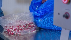 Arranging a bag with many pills with it Stock Footage