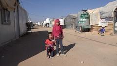 Veiled Muslim girl and sister posing in Syrian refugee camp Jordan Stock Footage