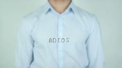 Adiós, Goodbye writing in Spanish on Glass Stock Footage