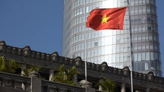 Vietnamese flag, old colonial building, new modern skyscraper Stock Footage