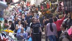 Crowds walk through popular outdoor Carmel market in Tel Aviv, Israel Stock Footage