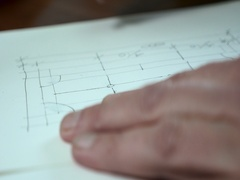 Man draws and erases blueprints Stock Footage