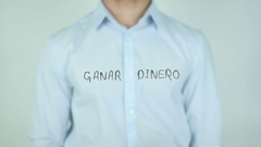 Ganar dinero, Earn Money writing in Spanish on Glass Stock Footage