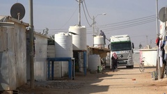 Freshwater distribution by truck in Zaatari Syrian refugee camp in Jordan Stock Footage