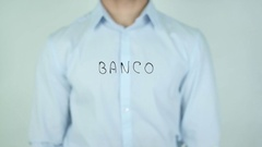 Banco, Bank writing in Spanish on Glass Stock Footage