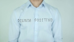 Piensa positivo, Think Positive writing in Spanish on Glass Stock Footage