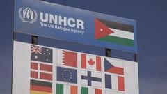 UNHCR refugee agency board in Syrian refugee camp Jordan Stock Footage