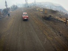 Russian Old Car Lada on Going a Dirt Road. View of the Burned Village. Aerial Stock Footage
