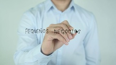Pequeños Negocios, Small Business writing in Spanish on Glass Stock Footage
