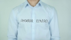 Ahorrar dinero, Save money writing in Spanish on Glass Stock Footage
