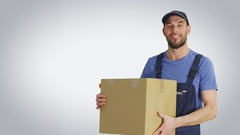 Mid Shot of a Handsome Loader Holding Cardboard Box. Young Man is Standing Stock Footage