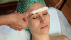 Woman doing cosmetic procedures Stock Footage