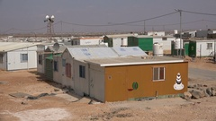 Cake shop and mosque in Syrian refugee camp in Jordan Stock Footage