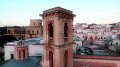 Sunset on a medieval town in the south of Italy. Aerial video. A pink tower. Stock Footage