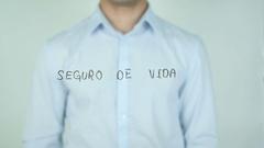 Seguro de Vida, Life Insurance writing in Spanish on Glass Stock Footage